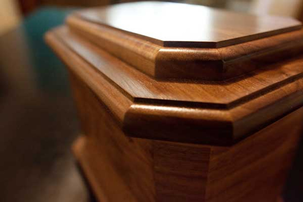 Octagon urn in walnut wood