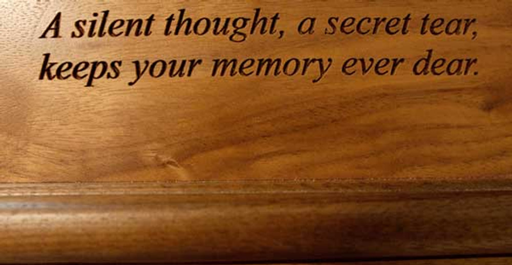 Laser engraved inscription in walnut wood