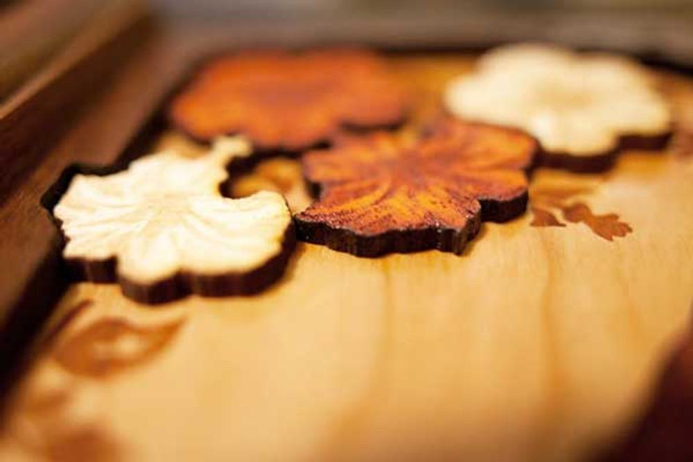 Flower artwork detail in Walnut wood urn