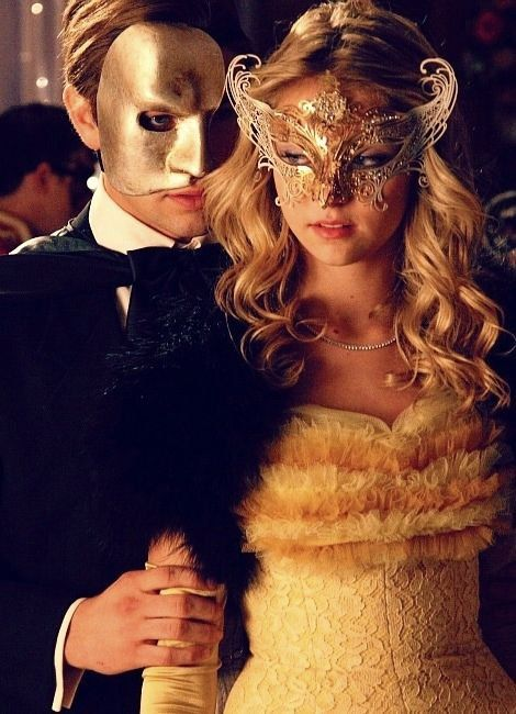 Couple's masquerade masks in gold men's masquerade mask and women's masquerade mask.
