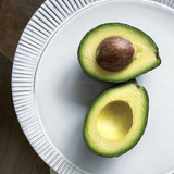 Hass avocado sliced open.