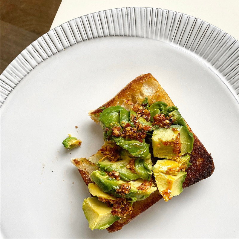 Avocado on a grliled roll finished with walnut oil, crunchy red pepper flakes & dried onion. YUM!