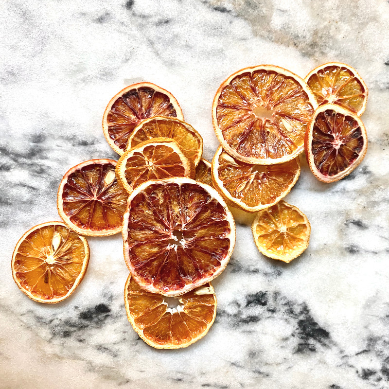 Gorgeous dried blood orange slices perfect for your tea, decorating cakes, or hanging in your window for a lovely fresh scent!