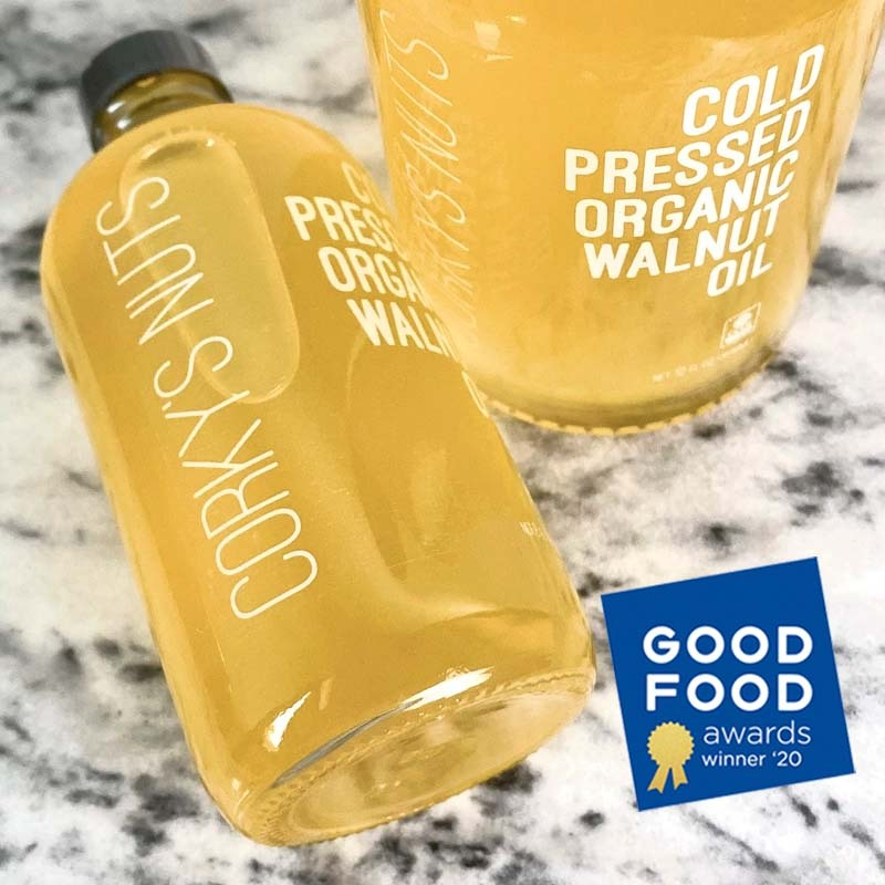 "Our ""award-winning"" Cold Pressed Organic Walnut Oil - 8oz bottle on left"