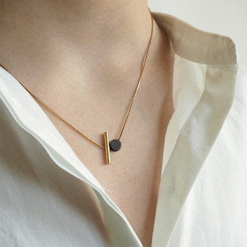 Cylinder + Disc Necklace model by Brass & Bold at Of Cabbages and Kings