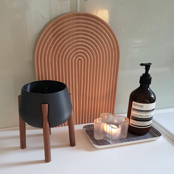 Dark Grey Tall Legged Planter bathroom by Studio Nilli at Of Cabbages and Kings