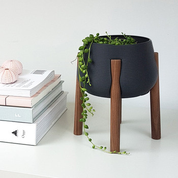 Dark Grey Tall Legged Planter with books by Studio Nilli at Of Cabbages and Kings