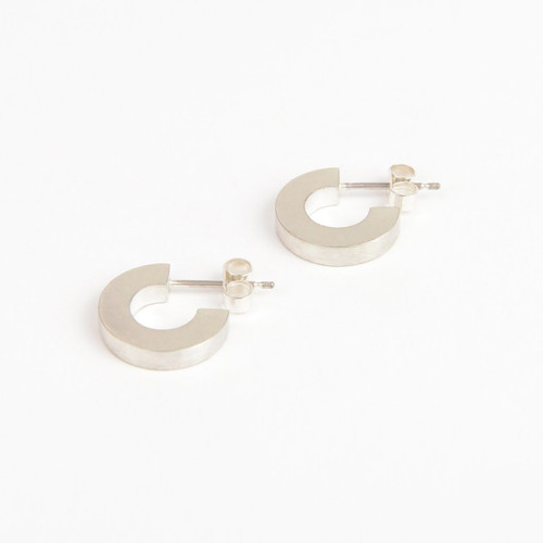 Solid silver Hoop earrings from the Béton range by Tom Pigeon, available at Of Cabbages ad Kings.