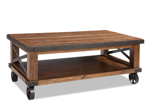 Taos Open Coffee Table with cast iron wheels •Constructed from solid Pine and Pine veneers with select hardwoods and metal accents •Coffee and side tables have metal stretcher for increased durability and aesthetic design •Coffee table available either with or without cast iron wheels offee Table with Caster