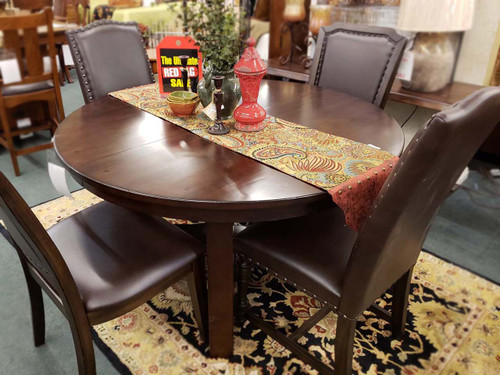 Clearance table and 4 chairs $979 while supplies last