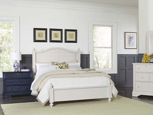 Panel bed in cream with low footboard and blue nightstand