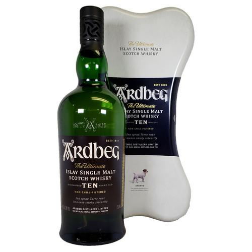 Ardbeg 10 year bottle stood in front of a larger white tin case in the shape of a dog bone.
