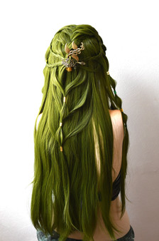 The lace front braided wig in green with barrettes and beads.