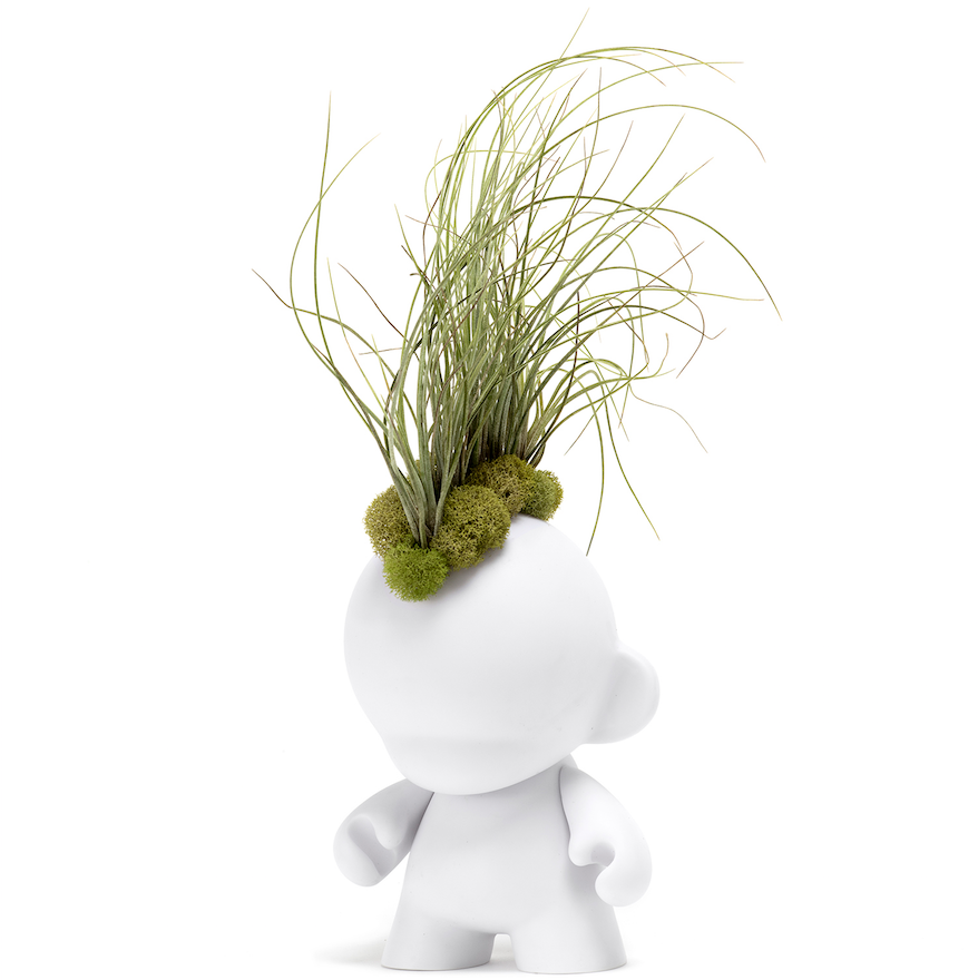 Munny figurine with a mohawk made from airplants