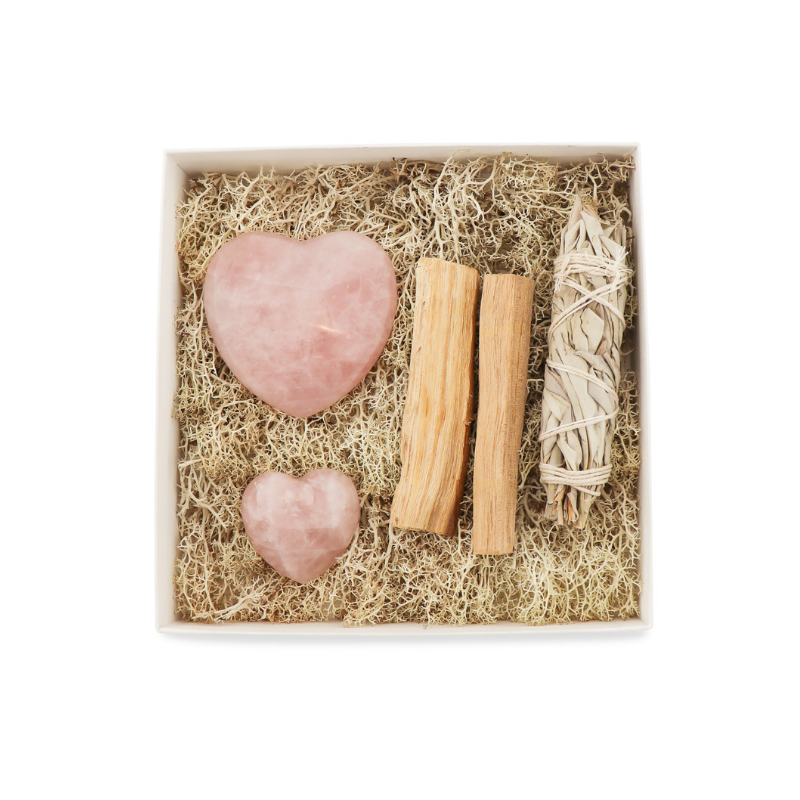 Gift box with rose quartz, sage, and palo santo