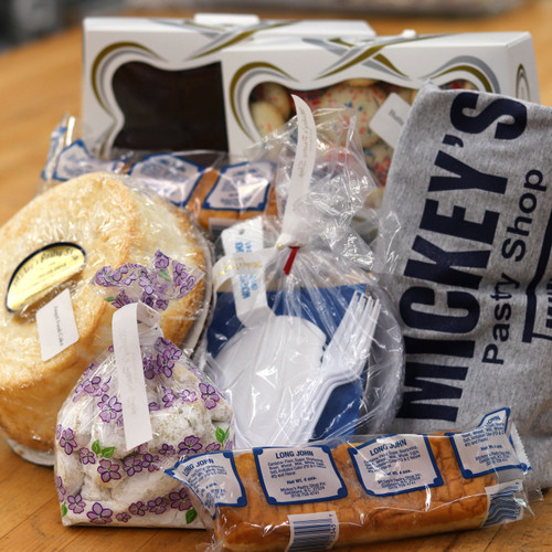 A Mickey's Pastry Shop T-shirt, a Long John, butter cookies, nutti fingers, brownies, angel food cake, disposable utinsels.