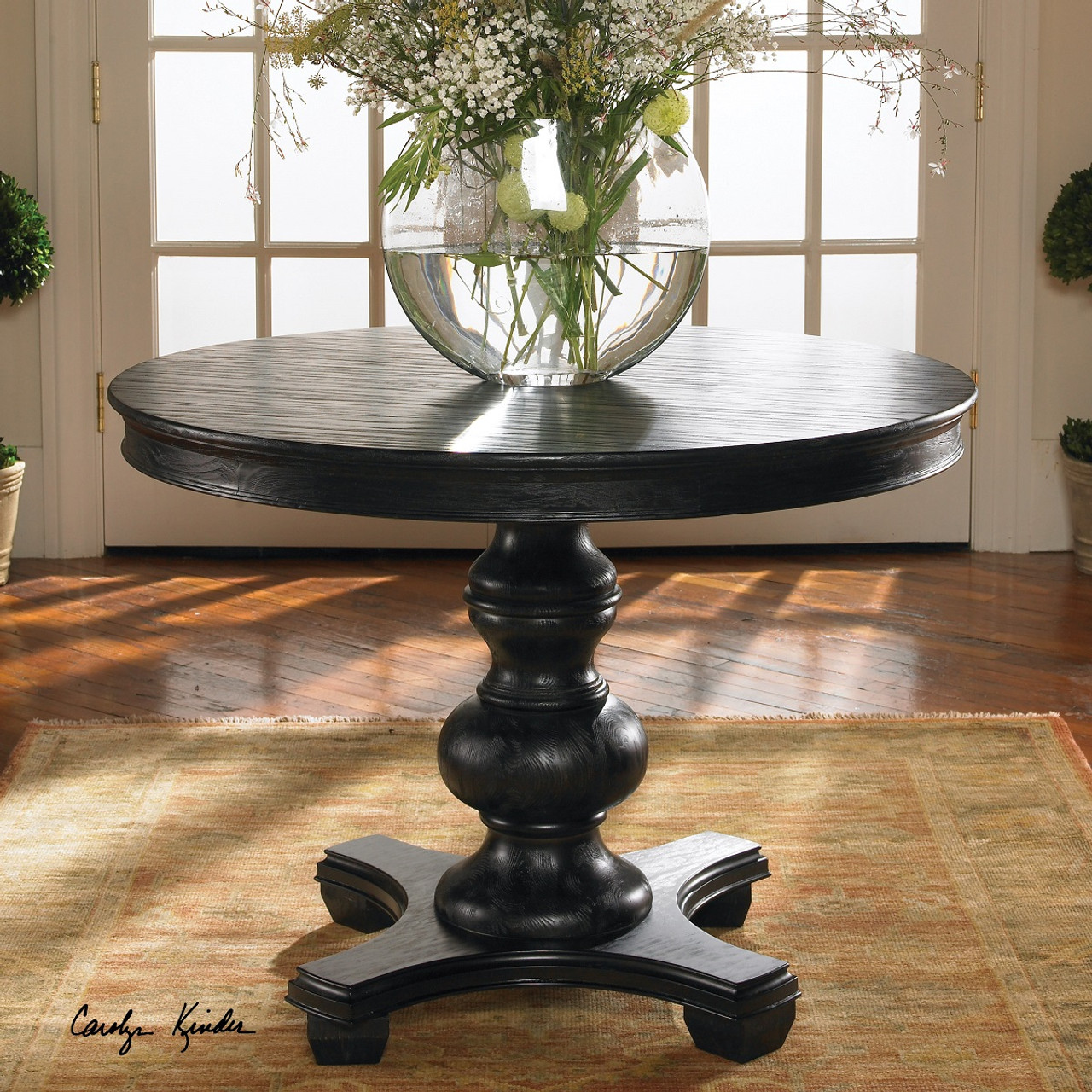 Brynmore black round pedestal accent table 42