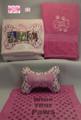 Pink ladybug with bone-shaped pillow