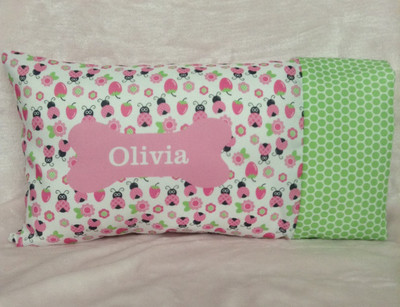 Ladybug print with green bubble trim