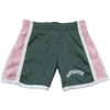 Girls green and pink shorts with 'Dartmouth' on the left leg in white