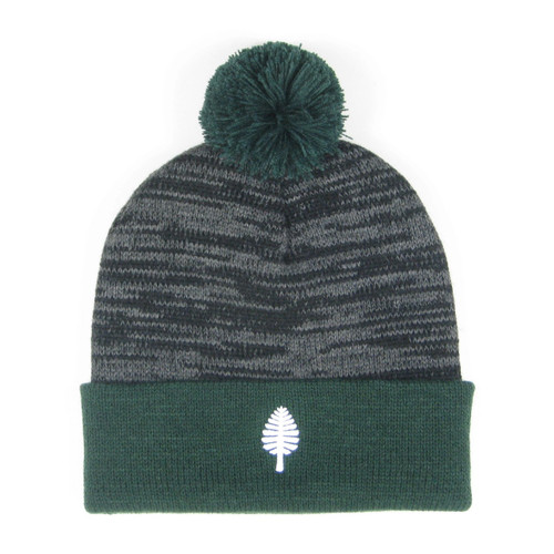 Grey and green winter hat with pom pom and white lone pine on the cuff