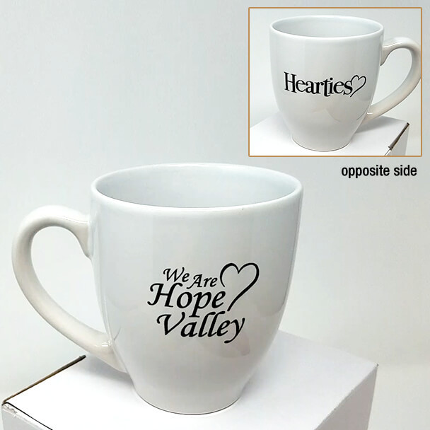 11oz. WHITE coffee cup showing both sides of cup and the logo - We are Hope Valley / Hearties.
