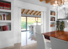 Here an Eclisse double pocket door is used to link an elegant kitchen area to a dining area.