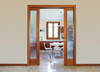An Eclisse double pocket door system can be used to divide a kitchen area and a living area.