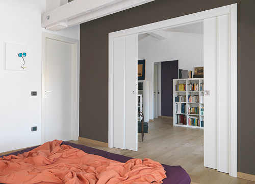 Create multi-functional spaces with a double telescopic pocket door system, for example a living area can be divided off into a sitting room and a guest room.