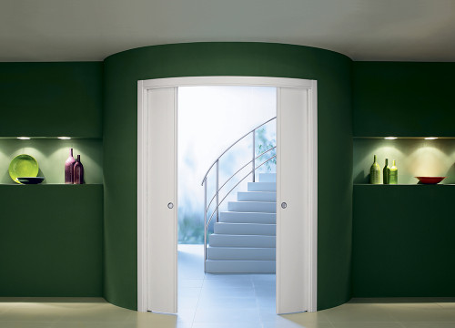 Make an entrance with an Eclisse curved pocket door.