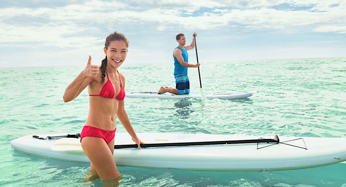 couple stoked on stand up paddle boarding