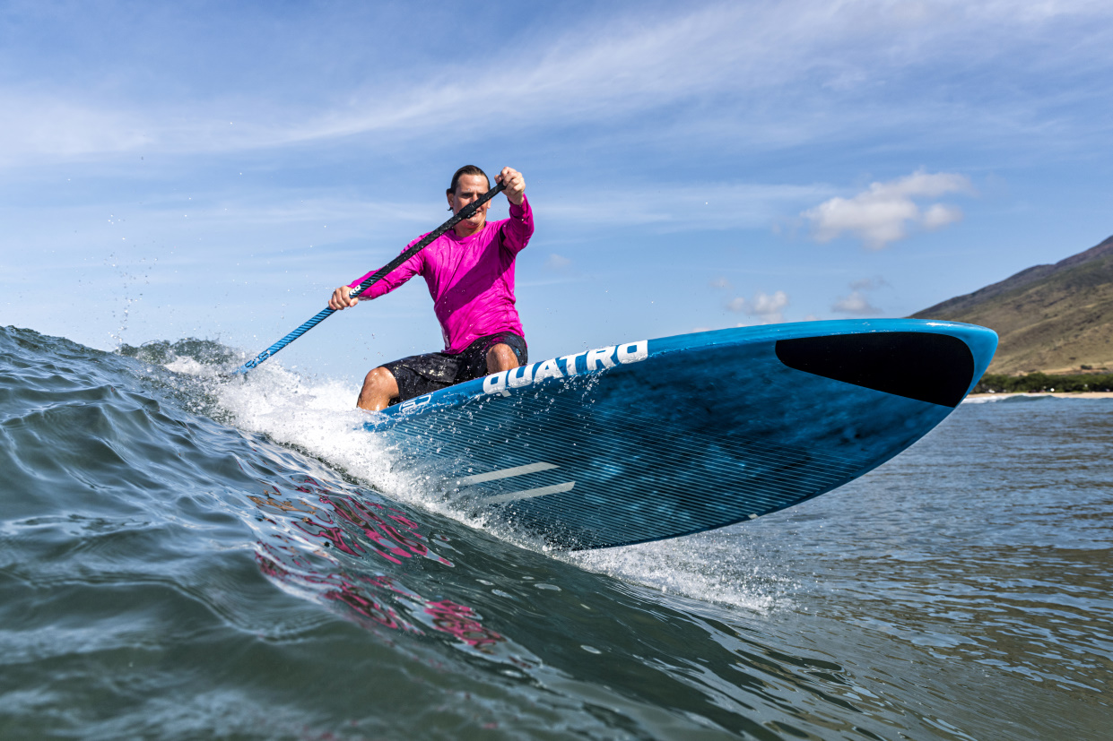 Woman on a Quatro surf SUP