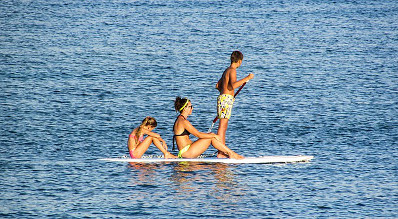 Family enjoying stand up paddle board.