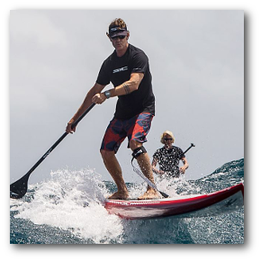 Two friends shred it up on their surf SUP boards