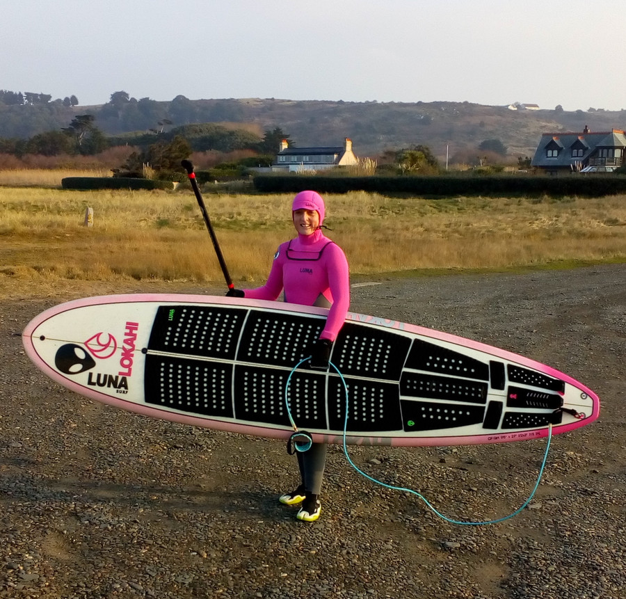 Verity Thomas SUPing with the Luna 9ft leash