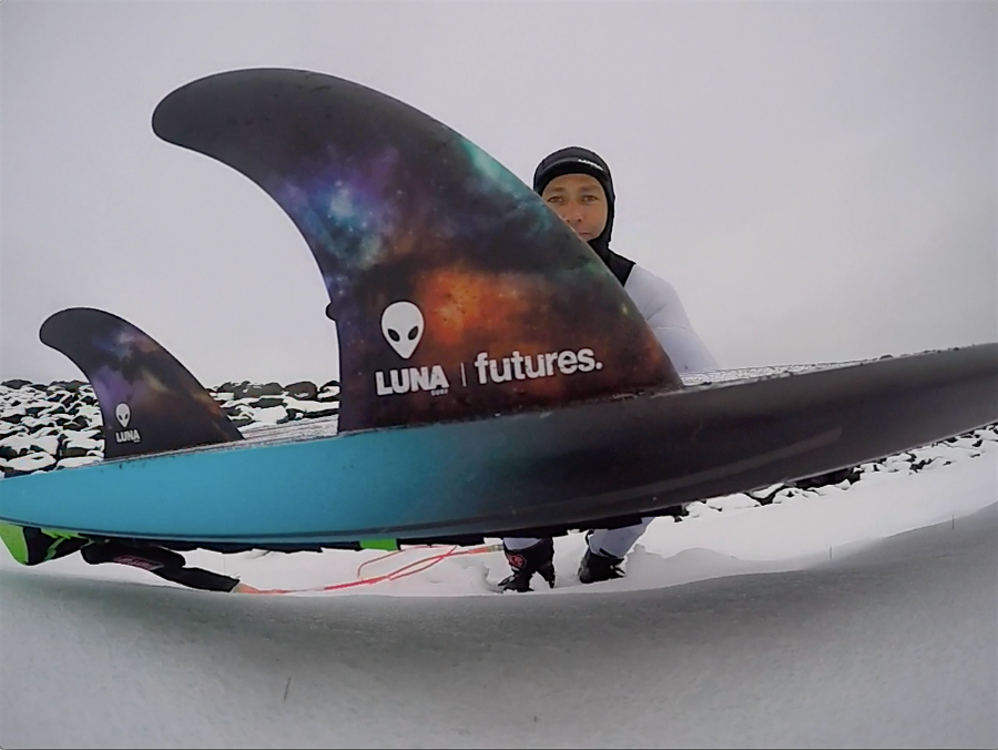Ian Battrick riding the Lunasurf Thruster fins camped out in the snow.