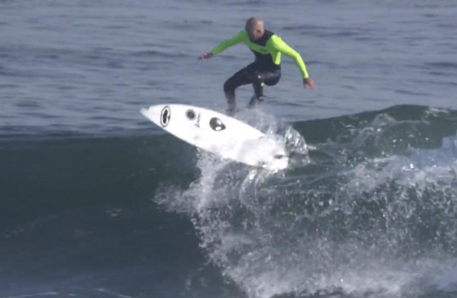 Zoltan Torkos surfing kickflip riding his signature front pad and Lunasurf tailpad -  Santa Cruz, California.