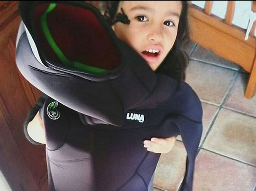 Basque surf girl Kailani Oyarzabal with her Lunasurf 6.4mm hooded wetsuit.
