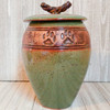 Handmade ceramic medium size two paw print urn in green and brown glaze pet urn. This individual craft artisan urn has a distinctive and unusual shape. 70 cubic inch capacity.