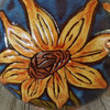 close up detail of the hand carved and handprinted sunflower