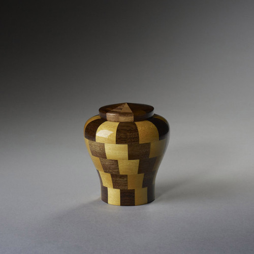 Keepsake size of our Faithful Wooden Pet Urn.  Cubic capacity of 13 cubic inches.  Made by an American Artisan from  Black Walnut and Yellow Heart woods.