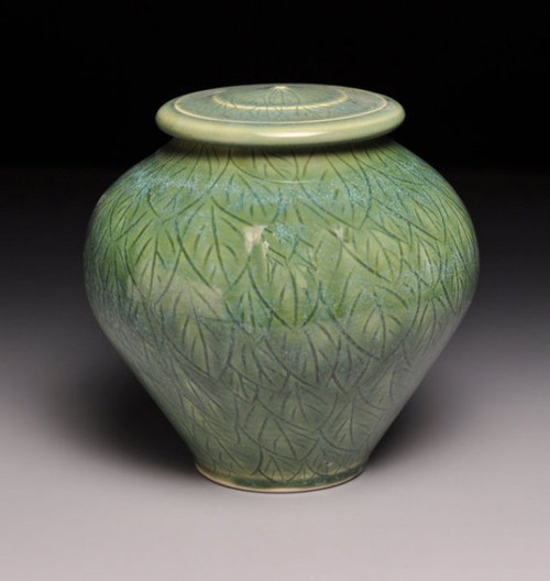 Green Leave Pet Urn featured in the large size.  Handmade ceramic pet urn.