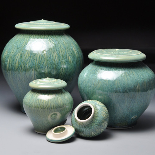 Green Leave Pet Urn Collection.  This collection is available in four different urn sizes.  The sizes range from 14 cubic inches to 220 cubic inches.  Each urn is individually made and can vary slightly from color and size