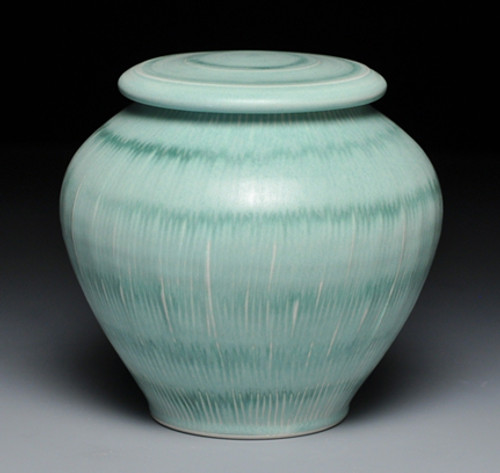 Individual picture of Green Grass Pasture handmade pet urn. Available for purchase @ spiritpeturns.com