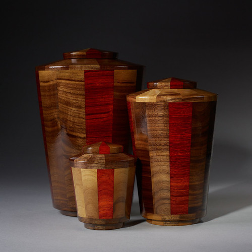 Glory Collection.  Handmade wooden pet urns.  Each urn is individually made from Black Walnut and Padauk woods.  Available in 3 different size for cats, dogs and horse urns.