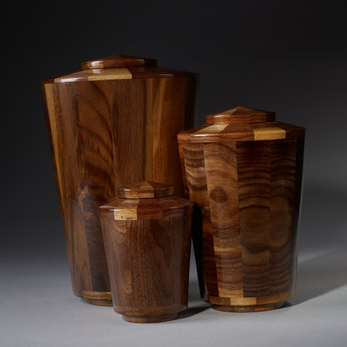 Joyful Collection Pet Urns. Handcrafted wooden pet urns made from black walnut. Available in 3 different urn sizes.  Suitable for cats or dogs.  Made by an American Artisan.