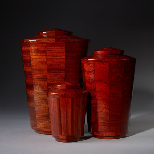Handmade wooden pet urns made from padauk wood.  A rich red color stain has been applied to this segmented wood turned pet urn collection.  Made in the US.  Available in 3 different urn sizes.