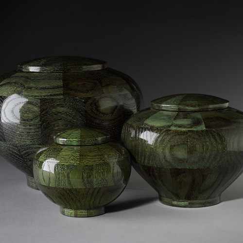 Precious Jewel Collection in Emerald. Handmade wooden pet urn made of oak.  In a rich green stain called emerald. Available in 3 different urn sizes.