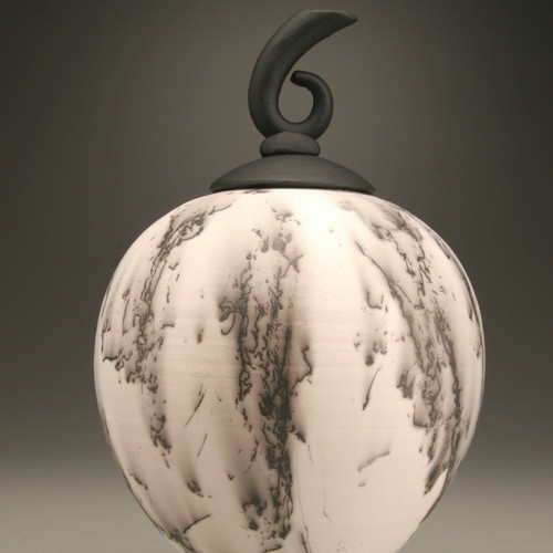 Horse Serenade Horse Hair Urn. Black and white ceramic lidded horse hair vessel with music clef lid. Made by an American master ceramic artist.  Now available in 3 more colors.