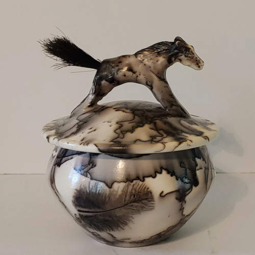 Handmade horse hair pony pottery keepsake urn. The tail of the pony is made with real horse hair.